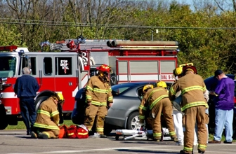 Fire fighters at the scene of a car accident